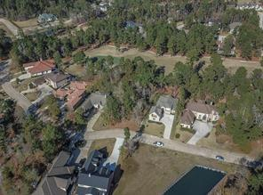 This is an estate-sized home site with views of Miller #9 green and Lake Conroe across the street.  It is nestled between two beautiful newly constructed homes.