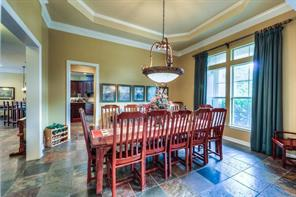Formal dining area has plenty of room for a large table and chairs as well as a hutch.