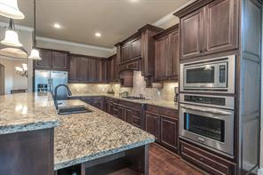 Gourmet style kitchen with all stainless steel Frigidaire Gallery Series appliances, including a five burner gas cook top.