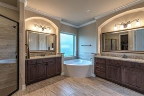 Exquisite and spacious master bath features two sinks, deep tub and beautiful separate shower. Spacious his and her closets add to the appeal of this master retreat.