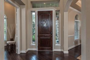 Beautiful entry way to greet your guests as they enter through the stately door into the grand foyer.