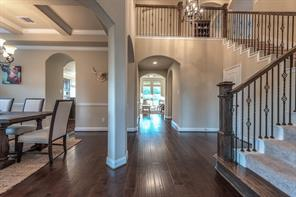 Hand scraped wood floors throughout the downstairs living spaces add to the elegance of this magnificent home.