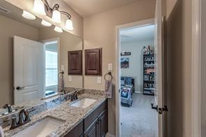 Jack and Jill style bath between two of the upstairs bedrooms includes beautiful granite.