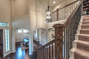 Elegant fixtures and wrought iron balusters enhance the grandness of the main entry.