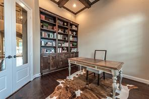 Handsome study with intricate ceiling details and gorgeous functional built ins.