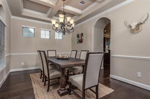 Formal dining also features sophisticated ceiling details.