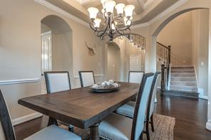 Another view of the formal dining with attractive light fixture and room for a large table.