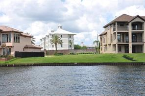 99  of water front per taxing authority located between two beautiful homes.