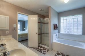 Master Bath with Separate Shower and Tub, Double Sinks and Big Walk-In Closet.