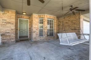 Check Out This Front Porch!  Swing and Fans to Keep Cool.