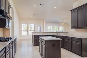 Kitchen is open to family room and breakfast area.  Kitchen features include gas range, granite counter tops, and plenty of storage!