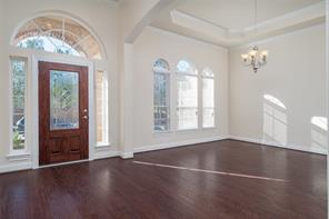 Next to the front door is the dining room with high ceilings and windows looking onto the front yard.