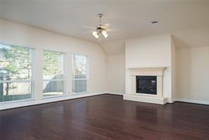Family room includes 10' ceilings, a wall of windows and a fireplace to keep you warm during these cold winter days.