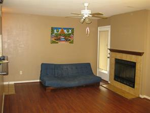 Nice space with a cozy fireplace, front and rear door access.