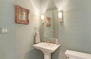 HALF BATH - Downstairs powder bath with seagrass wallpaper and natural brass finishes!