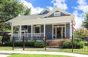 FRONT OF HOME - Street View.Charming Queen Anne style home with large wrap around porch.Fully fenced corner lot! Front porch with stained ceiling & gas lantern.