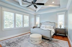 MASTER BEDROOM - Large spacious room with large windows that allow natural lighting to illuminate the wood flooring and high end finishes.