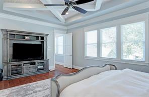 MASTER BEDROOM - Large spacious room with large windows that allow natural lighting to illuminate the wood flooring and high end finishes. Unique ceiling design.