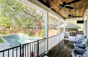 POOL/PATIO - Back patio with outdoor kitchen overlooking the pool! Your very own backyard oasis!