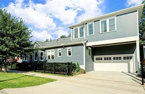 DRIVEWAY/SIDE OF HOME - Large driveway with automatic gate and fully fenced corner lot.