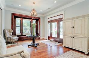 """FOYER - Open entry space and 6"""" white oak wood floors throughout the house. Also includes original built-ins that where re-furbished in 2016."""