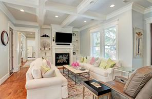 FORMAL LIVING - Spacious well lit area with fireplace and stunning finishes.