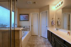 Master bathroom with walk in shower and soak tub.