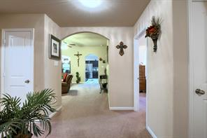 Another view of the entry way/hallway leading to living room.