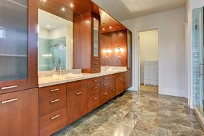 Impressive Master bathroom with custom finishes includes a double sink, generous sized mirrors, a massive walk-in closet and plenty of storage space.