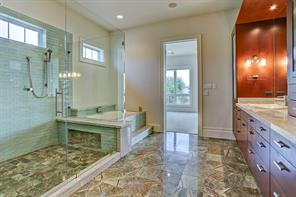 Additional view of the Master bathroom featuring the huge walk-in shower and separate bath tub.