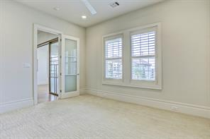 Upstairs secondary guest bedroom contains plantation shutters, high ceilings and radiates a pleasant ambiance.