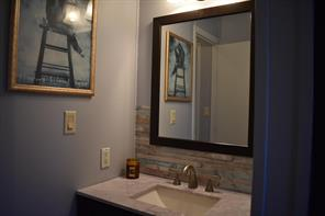 2nd bathroom has a beautiful vanity.