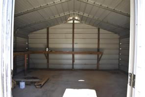 Fantastic 20' x 20' workshop. Electric power. Concrete floor.