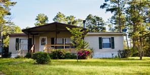 A charming home on 2 acres in Shady Oak Estates. This land is fenced and cross-fenced.