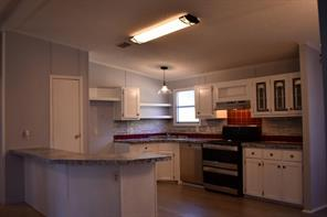 Light and bright kitchen. Great counter space. Stainless appliances. New vent hood.