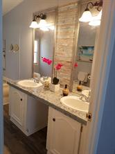 Master bath with double sinks, tub and separate shower.