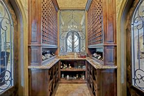 This view shows the other side of the wine room which stores even more wine and includes a U shaped granite countertop. Truly a wine collectors dream.