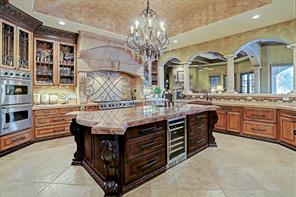The heart of the home typically centers around the kitchen and this kitchen is a true beauty with all the bells and whistles. Stunning groin vaulted ceiling is completely tiled. Entertain around this massive sienna bordeaux granite island with beveled edges and elaborate shape.