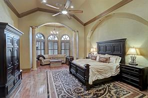 Bay windows envelop the sitting area at the back of the spacious master bedroom providing a comfortable nook for relaxing.