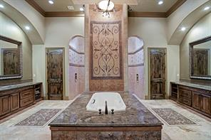 Enter the majestic master bath on the first floor with double etched bronze sinks, duplicated inlaid mosaics AND double water closets. The shower connects from both entrances behind the towering mosaic on the wall for a luxurious shower experience, and the air bathtub supplies a non-aggressive soft tissue massage.
