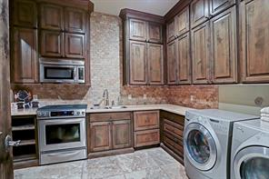 On the first floor, tucked behind the main kitchen is the second caterer's kitchen with 4 gas burner stove, microwave, 2 dishwasher drawers, full built-in refrigerator and full sized wine refrigerator.