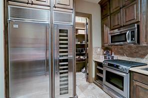 This space is optimal for large gatherings and a great hub for caterer's to work their magic. Huge pantry behind for lots of storage.