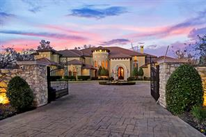 Arrive through the decorated wrought iron gate surrounded by stone columns. The treasured water fountain with rich history sits in the center of the circle driveway.