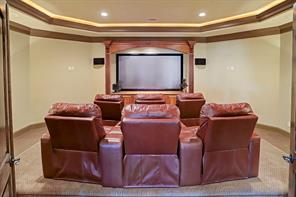 Bring Hollywood home with this exciting home cinema. Two tiered seating with 6 leather power recliners that have detachable snack trays provide the ultimate movie theater experience. State of the art gadgets include the Black Diamond projection screen and Bowers & Wilkins surround sound speakers.