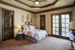 One of four secondary bedrooms in the main residence. Each of the bedrooms on the second floor have their own balconies and large walk-in closets.
