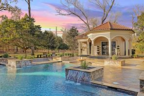 Enjoy the calming harmonies of the pool fountain and waterfalls while taking on the gorgeous sunset view and alluring outdoors. Behind the pool lies the 886 square feet Casita which houses a bedroom, full bath, living room and kitchen.