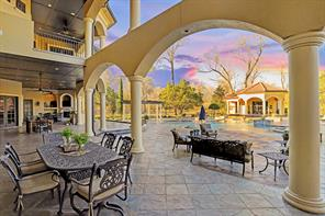 This view of the covered patio shows how expansive this entertaining space really is. There are FOUR seating areas pictured here. Up above is the huge upstairs patio that sits off the game room.