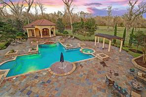Picturesque views of the stunning backyard grounds. Great privacy as there are no neighbors behind and the lot to the right of the fence belongs to this property.
