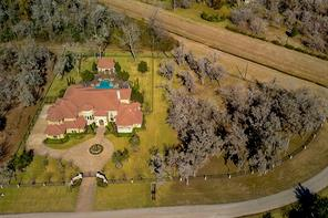 From an overhead view, the 3.58 acres encompasses the two lots shown. The lot to the right of the residence may be built on in accordance with HOA rules and regulations.