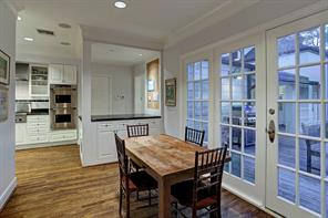"""GRANITE KITCHEN – 12' X 17' 8"""": Granite counters & tile backsplash; Under-cabinet lighting; Double basin sink, filtered water tap & disposal; Windows over sink with slab granite display shelf; LG® dishwasher; KitchenAid® built-in stainless steel refrigerator/freezer; Thermador® Pro 6-burner gas cooktop & lava-rock grill; Thermador® Pro stainless steel vent, light & heat lamps; Dacor® double ovens; upper with convection capabilities; Granite-topped peninsula with cabinets & bookshelf"""